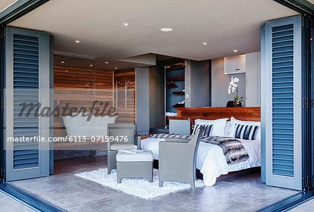 Patio doors open to modern bedroom