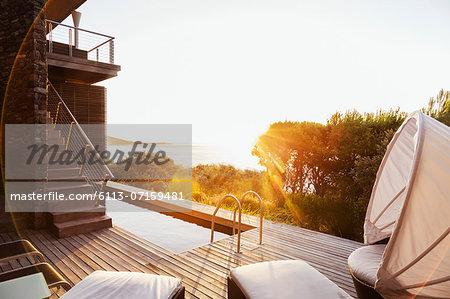 Luxury patio overlooking ocean at sunset