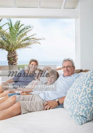 Older couple with grandchildren on sofa