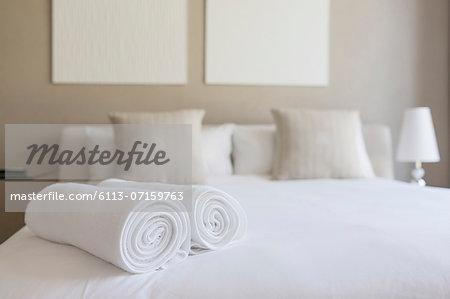 Towels on bed in bedroom