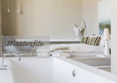 Bathtub in modern bedroom