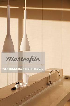 Sink and pendant light in modern bathroom