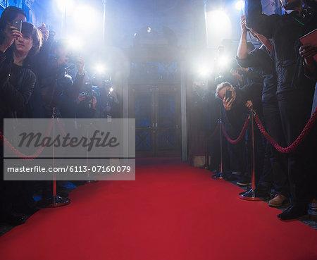 Paparazzi using flash photography along red carpet