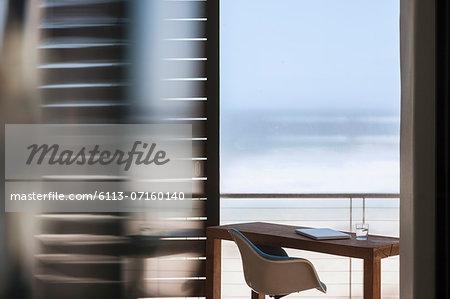 Desk on patio overlooking ocean