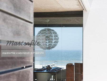 Chandelier above dining table overlooking ocean