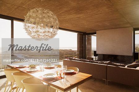 Modern dining room and living room overlooking ocean