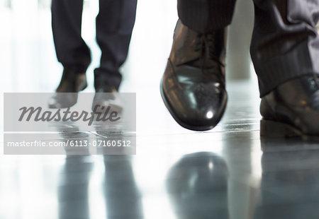 Close up of businessmens feet
