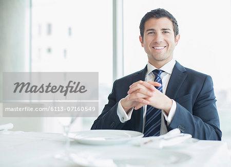 Businessman smiling in restaurant