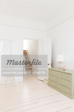 Bedroom door leading to staircase
