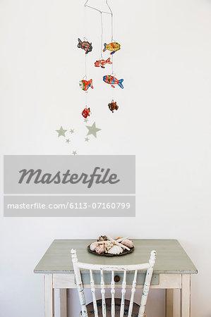 Fish mobile hanging over desk