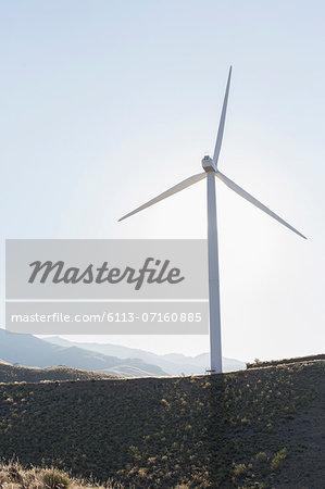 Wind turbine spinning in rural landscape
