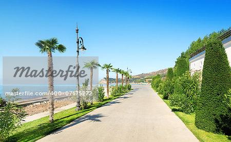 Beautiful promenade near the sea in sunny summer day