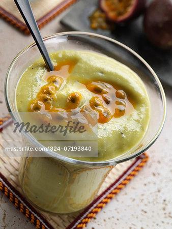 A glass of avocado passionfruit smoothie
