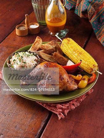 Chicken Piri Piri leg coleslaw spicy wedges sweetcorn on the cob