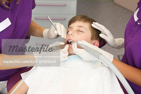 Boy patient having dental treatment