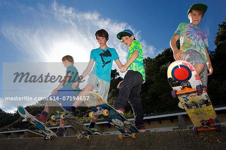 Portrait of four boys on skateboards