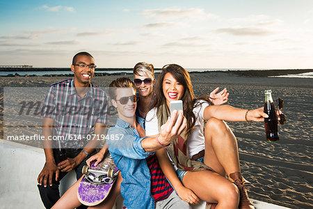 Friends photogrpahing themselves, Mission Beach, San Diego, California, USA