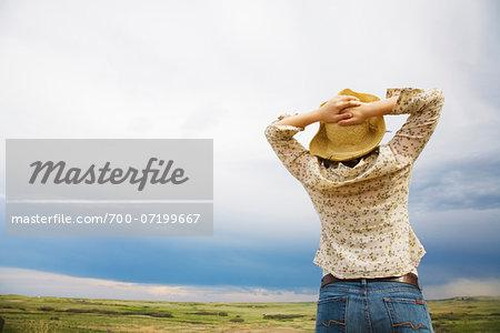 Woman Looking over Horizon, Alberta, Canada
