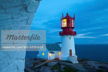 The idyllic Lindesnes Fyr Lighthouse illuminated at dusk, Lindesnes, Vest-Agder, Norway, Scandinavia, Europe