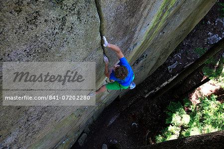 A climber soloing a difficult crack climb, Squamish Chief, Squamish, British Columbia, Canada, North America
