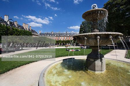 Fountain in Place des Vosges in The Marais, Paris, France, Europe