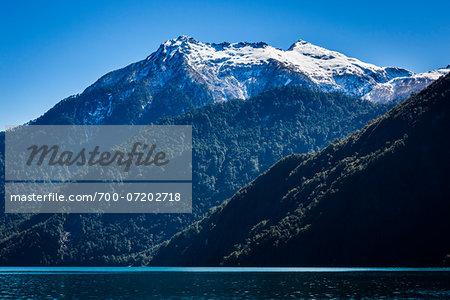 Scenic view of mountains and lake, Lake Todos los Santos, Parque Nacional Vicente Perez Rosales, Patagonia, Chile