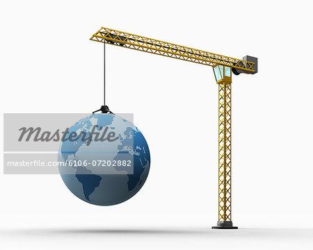 A crane carries a globe