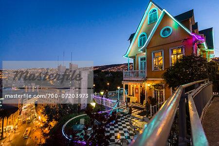 View of city street and skyline at night, Valparaiso, Provincia de Valparaiso, Chile