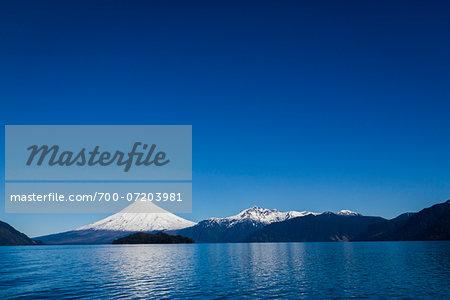 Scenic view of Todos los Santos Lake, with Osorno Volcano and mountain range in the distance, Parque Nacional Vicente Perez Rosales, Patagonia, Chile