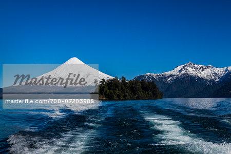 Backwash from boat in Lake Todos los Santos and Osorno Volcano, Parque Nacional Vicente Perez Rosales, Patagonia, Chile
