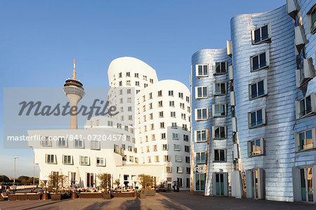 Rheinturm tower and Gehry Haus building, Medienhafen, Dusseldorf, North Rhine-Westphalia, Germany, Europe