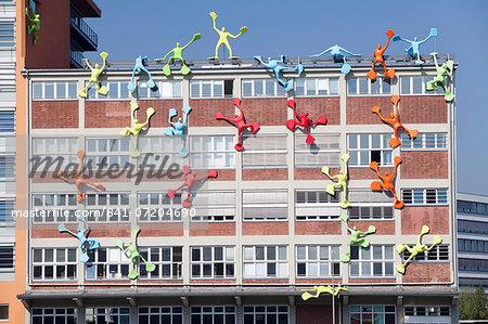 Flossies figures covering the Roggendorfer Haus, Media Harbour (Medienhafen), Dusseldorf, North Rhine Westphalia, Germany, Europe