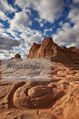 Sandstone swirl under clouds, Coyote Buttes Wilderness, Vermillion Cliffs National Monument, Arizona, United States of America, North America
