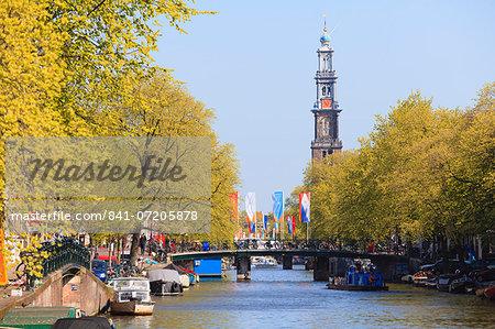 Westerkerk church tower by Prinsengracht Canal, Amsterdam, Netherlands, Europe