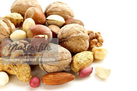 Assortment of different nuts (peanuts, hazelnuts, pistachios, walnuts)