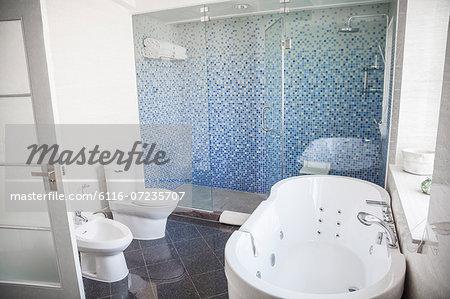 Modern, clean, bathroom with toilet, sink, shower and bathtub.