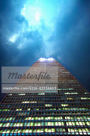 Office skyscraper, low angle, dramatic sky