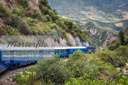Hiram Bingham train travelling through scenic hills, Peru