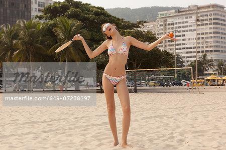 Woman standing with funny gesture on Copcacabana Beach, Rio de Janeiro, Brazil