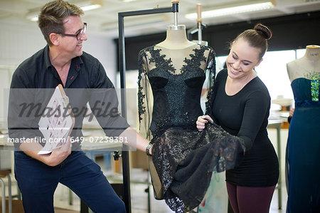 Fashion design teacher assessing student