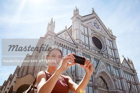 Woman outside Santa Croce church, Piazza di Santa Croce, Florence, Tuscany, Italy