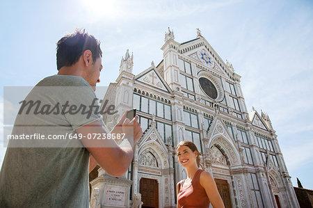 Man and woman outside Church of Santa Croce, Piazza di Santa Croce, Florence, Tuscany, Italy