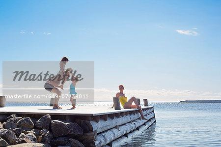 Young family on pier, Utvalnas, Gavle, Sweden