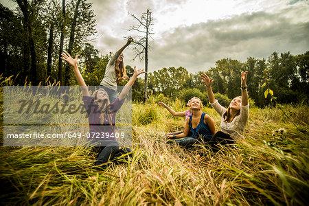 Five young women watching kite