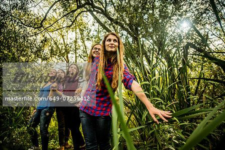Five young women exploring marshland
