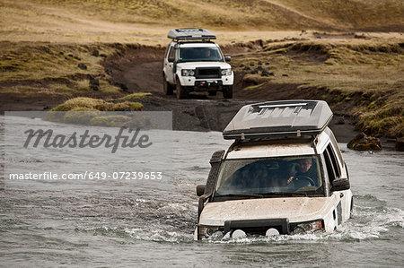 SUV crossing deep river, Fjallabak, Iceland