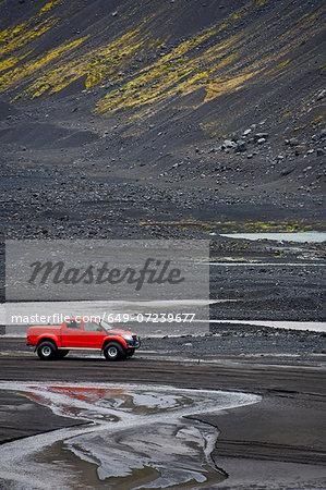 Customised SUV on sandy river bed close to Eyjafjallajokull, Thorsmork, Iceland