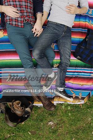 Gay couple on rainbow blanket