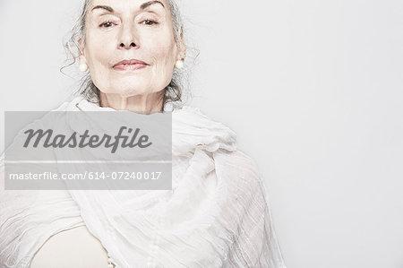 Cropped studio portrait of senior woman