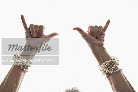 Studio shot of mature woman's gesturing hands